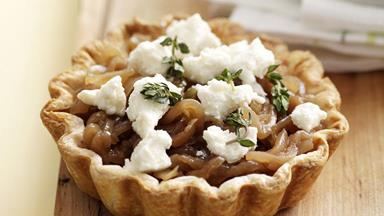 Caramelised onion and ricotta tarts