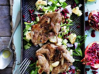 char-grilled quail with cauliflower and pomegranate salad