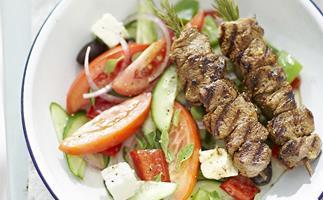 Lemon and garlic lamb kebabs with greek salad