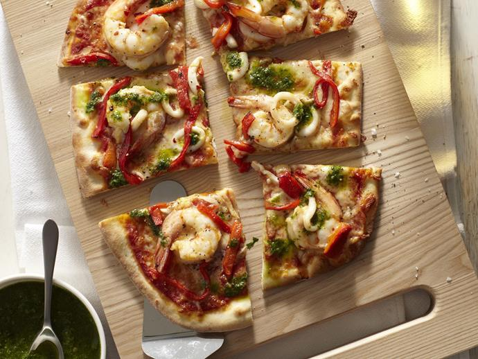 "Loaded with fresh seafood, this **[prawn, squid and salsa verde pizza](https://www.womensweeklyfood.com.au/recipes/prawn-squid-and-salsa-verde-pizza-4492|target=""_blank"")** is the perfect dish when entertaining guests."