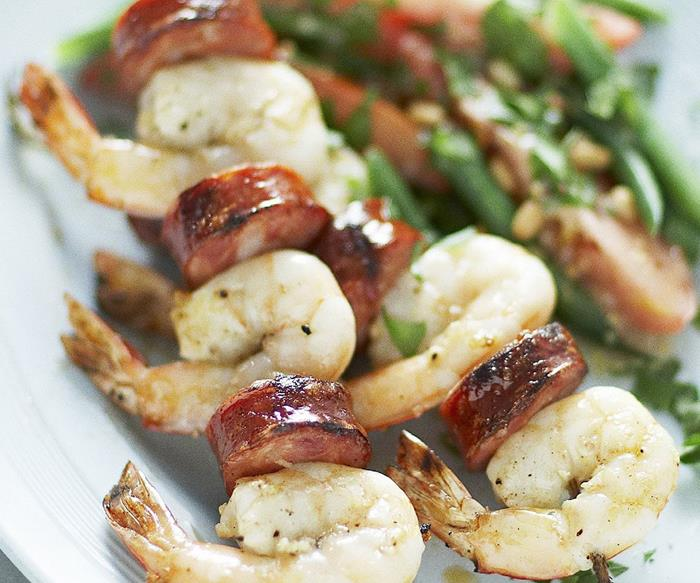 Prawn and chorizo skewers with bean and tomato salad