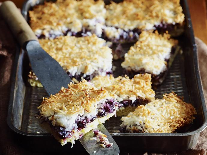 """Fill the tins with this delectable, crunchy-topped [blueberry slice](https://www.womensweeklyfood.com.au/recipes/blueberry-macaroon-slice-9741