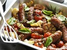 Baked beef sausages with rosemary and tomato