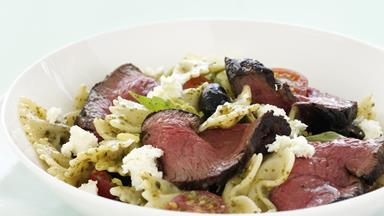 Beef fillet with warm tomato, pesto and olive pasta