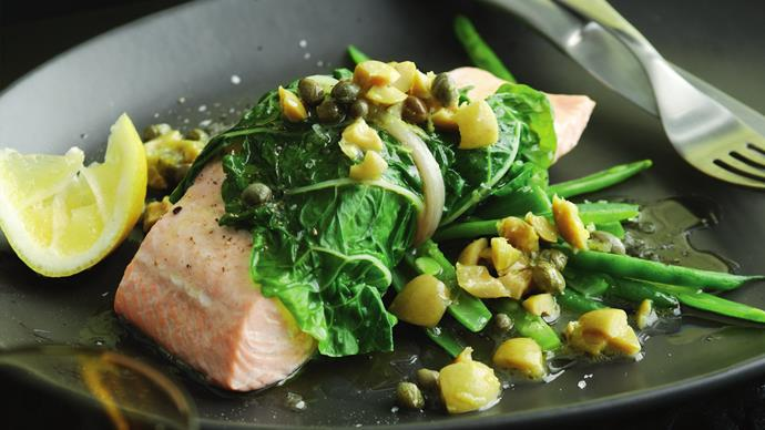 steamed salmon in spinach with lemon, olive and caper sauce