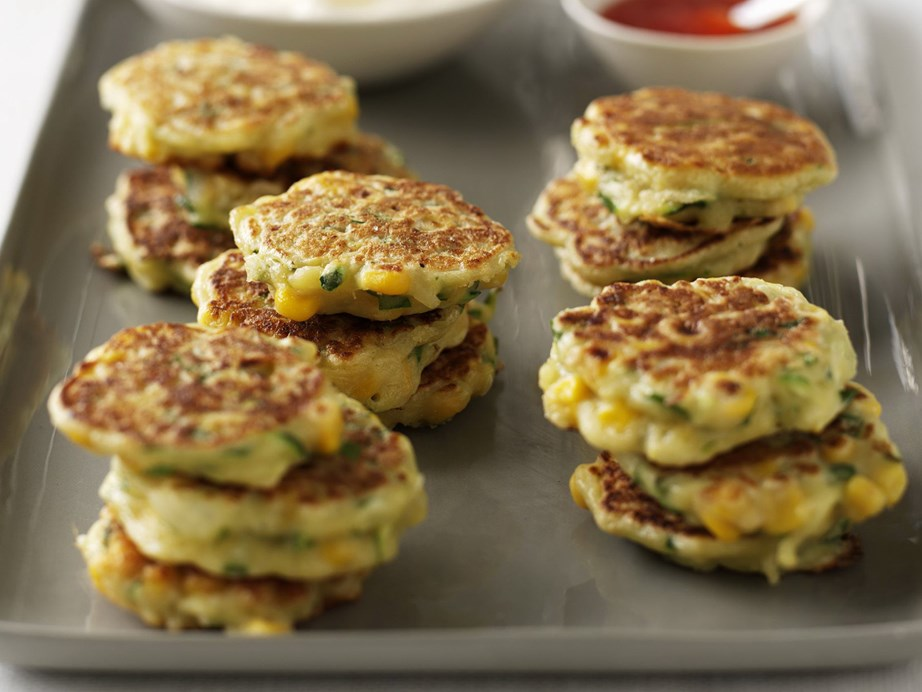 "**[Corn fritters with sour cream](https://www.womensweeklyfood.com.au/recipes/corn-fritters-with-sour-cream-11103|target=""_blank"")** These light, fluffy and delicious corn fritters are perfect picnic snacks."