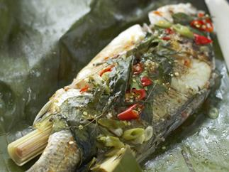 hot and sour fish steamed in banana leaves