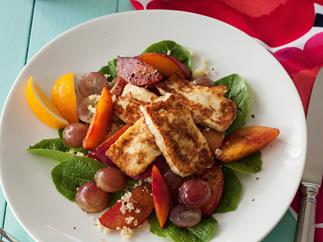 Fried haloumi with red grapes and grilled nectarines on couscous