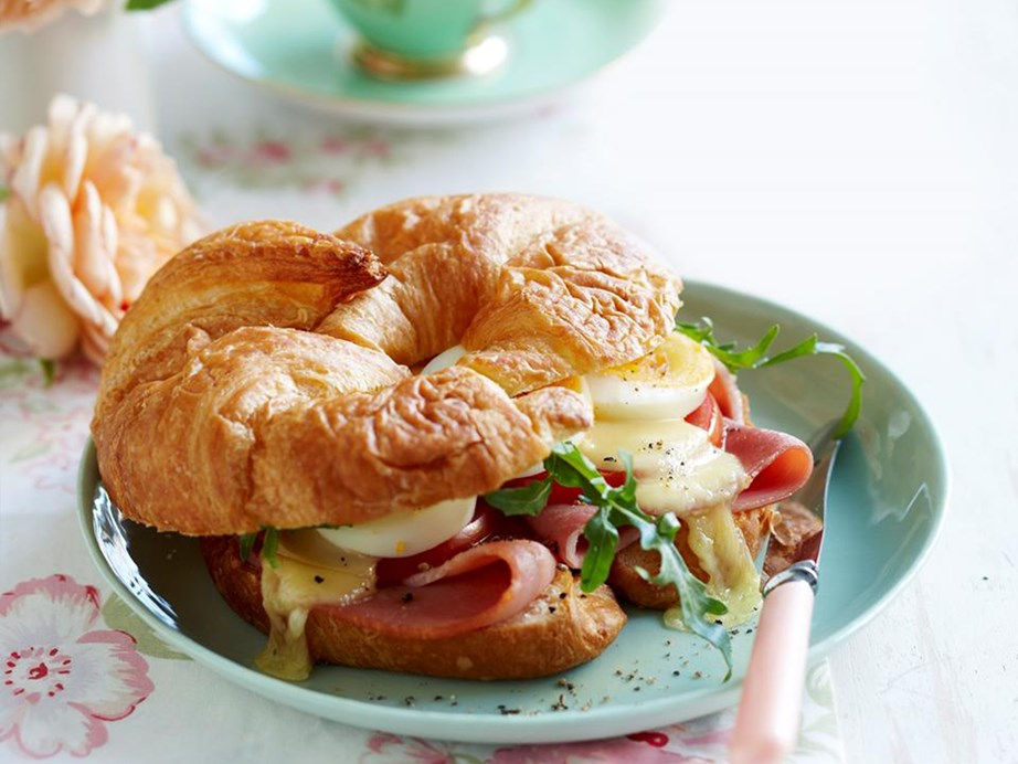 """This light, [flaky golden croissant is beautiful stuffed with fresh ham, eggs and oozy melted cheese](https://www.womensweeklyfood.com.au/recipes/breakfast-croissants-18196
