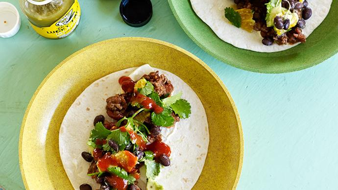 Soft flour tacos with chilli beef sauce and black bean salad