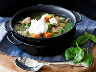 Chicken ragout soup with peas and sour cream