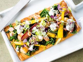 Glazed baby vegetable tart with creamy blue cheese