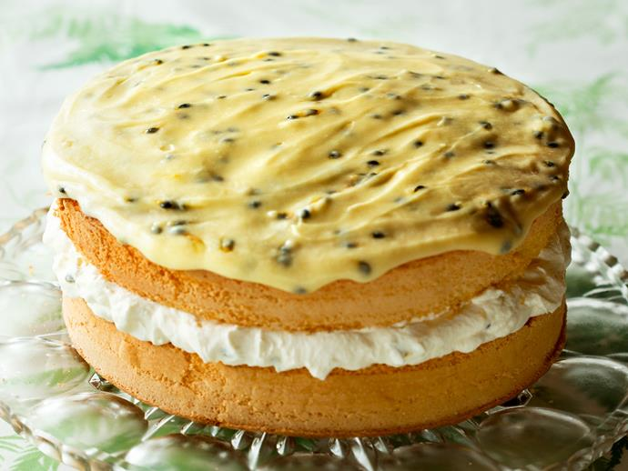 """**[Feather sponge](https://www.womensweeklyfood.com.au/recipes/feather-sponge-cake-with-passionfruit-icing-28603 target=""""_blank"""")** filled with clouds of whipped cream and topped with passionfruit icing."""