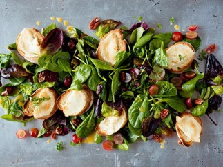 Toasted goat's cheese with grapes, pecans and summer greens