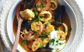 Spanish seafood stew with aioli