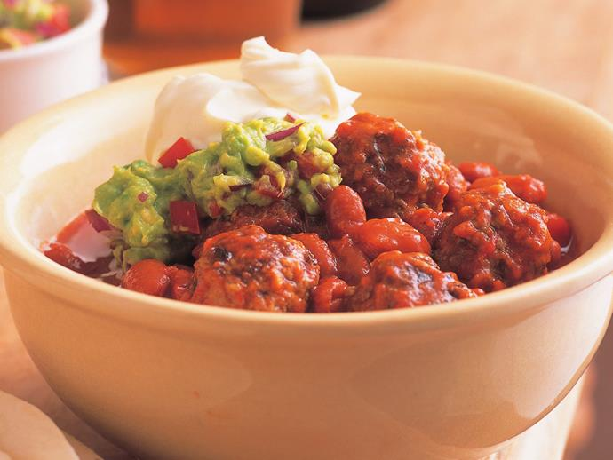 """**[Mexican meatballs in a spicy tomato sauce](https://www.womensweeklyfood.com.au/recipes/mexican-meatballs-with-guacamole-6745 target=""""_blank"""")** and topped with guacamole makes a delicious dinner served with wraps and salad."""