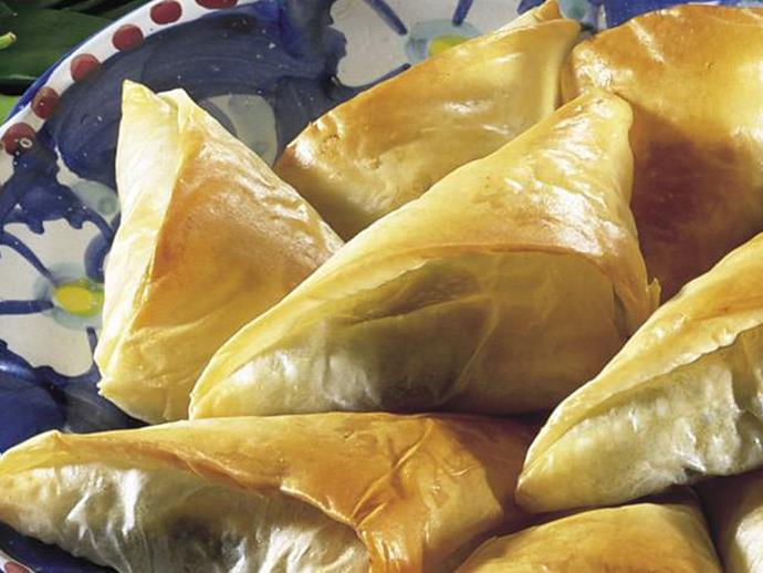 """These tasty little Greek-style [cheese and spinach filo triangles](https://www.womensweeklyfood.com.au/recipes/cheese-and-spinach-triangles-6728