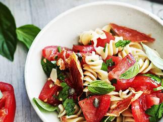 Pasta salad with tomato and crisp prosciutto