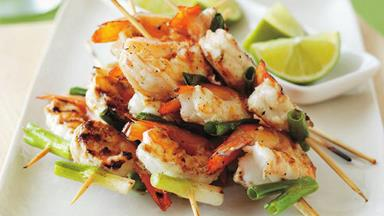 Prawn skewers with lime and green onions
