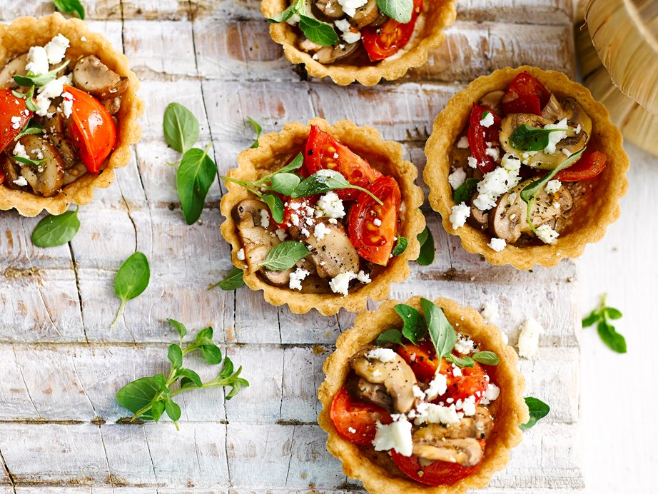 """**[Mushroom and tomato tarts](https://www.womensweeklyfood.com.au/recipes/mushroom-and-tomato-tarts-1-28679