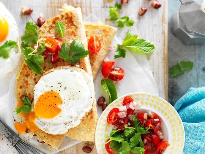 "This tasty [Mexican inspired breakfast quesadilla](https://www.womensweeklyfood.com.au/recipes/breakfast-quesadillas-14359|target=""_blank"") encases oozy cheese, runny eggs and hearty beans to create a healthy, flavour-packed breakfast or lunch that will fuel you for the day."