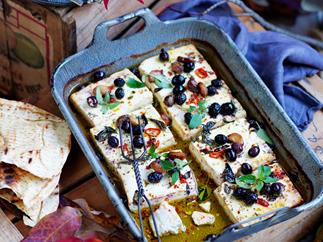 Baked feta with roasted garlic, chilli and olives