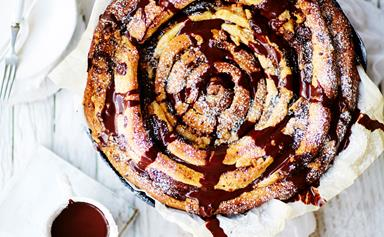 Giant skillet chocolate and cinnamon spiral with chocolate sauce