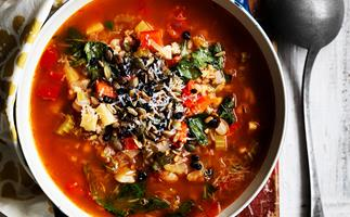 Barley and vegetable soup with crunchy seeds