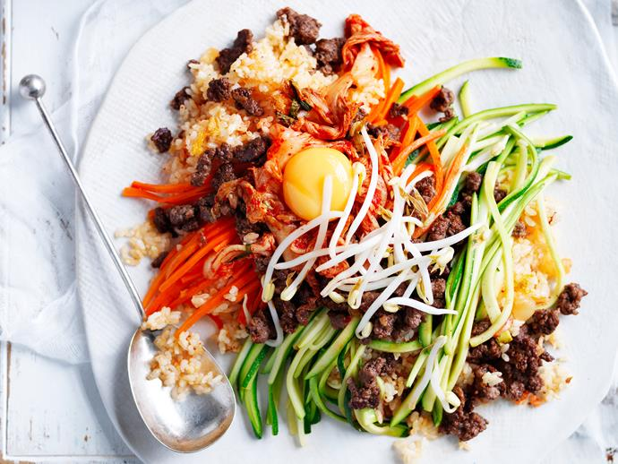 "A colourful mix of rice, meat and veggies, this is the Korean [bibimbap](https://www.womensweeklyfood.com.au/recipes/rice-cooker-bibimbap-28893|target=""_blank"") in rush mode. Don't forget to top it up with the egg. It adds a creamy richness that binds everything together."