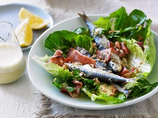 Caesar salad with grilled sardines