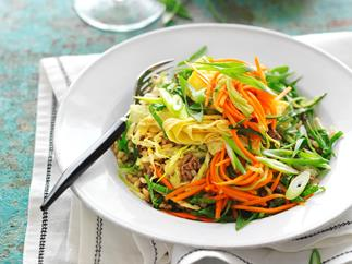 stir-fried beef and brown rice with carrot and cucumber pickle