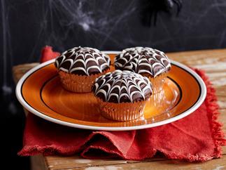Choc cobweb cupcakes