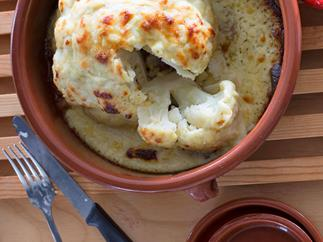 Whole baked cauliflower cheese