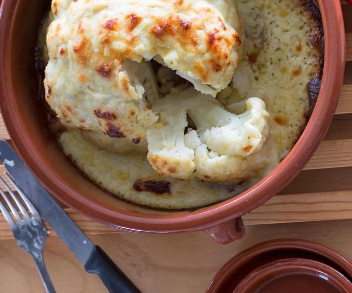Whole baked cauliflower cheese