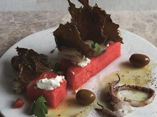 George Calombaris' grilled calamari, watermelon, olives, goats curd, crispy vine leaves