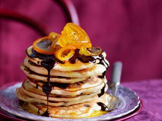 orange pancakes with chocolate sauce
