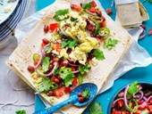 Scrambled eggs, smashed avocado and bean breakfast wrap