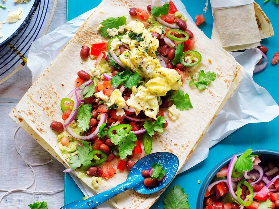 """Rise and shine with this hearty and delicious [scrambled egg, smashed avocado and bean breakfast wrap](https://www.womensweeklyfood.com.au/recipes/scrambled-eggs-smashed-avocado-and-bean-breakfast-wrap-29253
