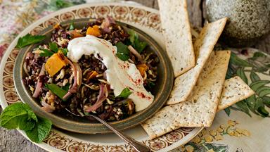 Lentil and rice salad with fried onions and yoghurt dressing
