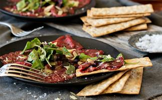 Summer beef carpaccio with marinated microgreens