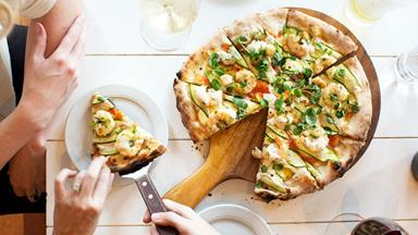 Prawn, chilli & courgette pizza with anchovy dressing