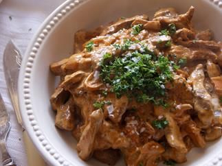 Venison stroganoff with saffron cap mushrooms and oven-baked chips