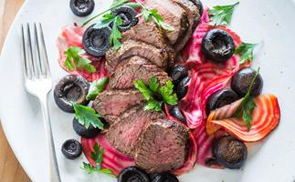 Peppered venison with candied beets and pickled mushrooms