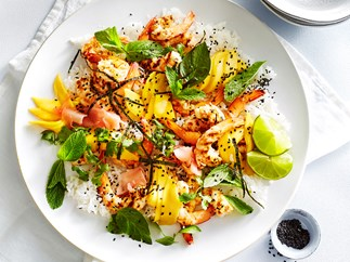 Sushi rice salad with grilled prawns and mango