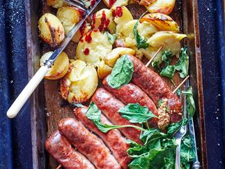 Sausages with crushed crispy potatoes