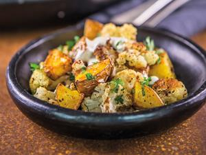 Roasted potatoes and cauliflower with tahini dressing