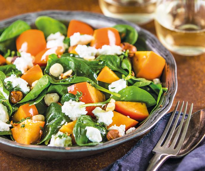 Spinach, persimmon, goat's cheese and hazelnut salad