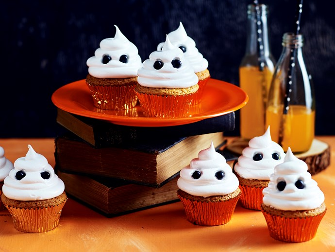 Halloween white chocolate ghost cupcakes with fluffy meringue icing