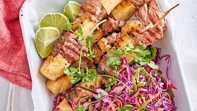 Pork and pineapple skewers with red cabbage salad