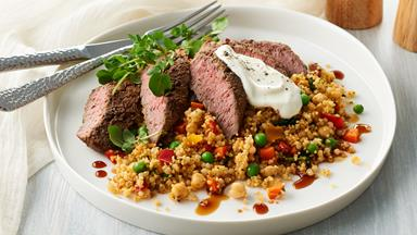 Pearl couscous with spiced lamb backstrap and pomegranate dressing